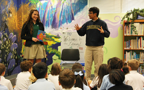 Upper School students read to Lower School students in French.